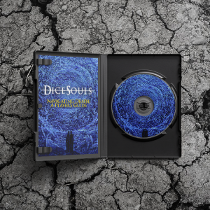 "A DVD case lying on a cracked stone surface. The case is open, revealing a booklet with a blue painting of a spiral of angels. A pair of silhouetted figures state into the void at the centre, where white text reads ""Dice Souls"". Beneath it, yellow text says ""Navigating Death: A Player's Guide"". On the right side of the case is a CD with the same blue spiral of angels on it."
