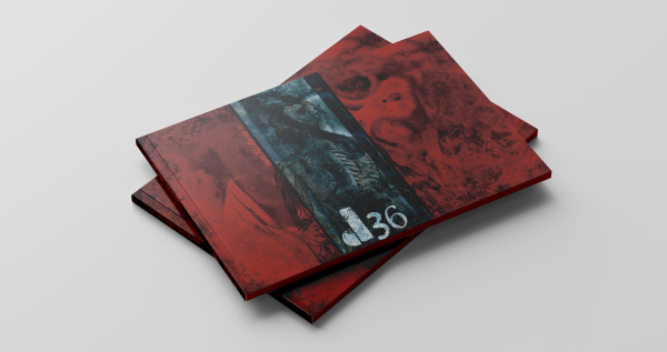 "A digital mock-up of a pair of landscape zines stacked on top of each other. The cover is overwhelmingly red. A blue strip like a photo negative runs down the middle, revealing a skeletal body. White text reads ""d36"""