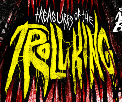 """Bloody teeth in a gaping black mouth surround jagged, sharp lettering in bright yellow that reads, """"Treasures Of The Troll King"""". A white logo in the top right corner reads, """"Compatible with Mork Borg."""""""
